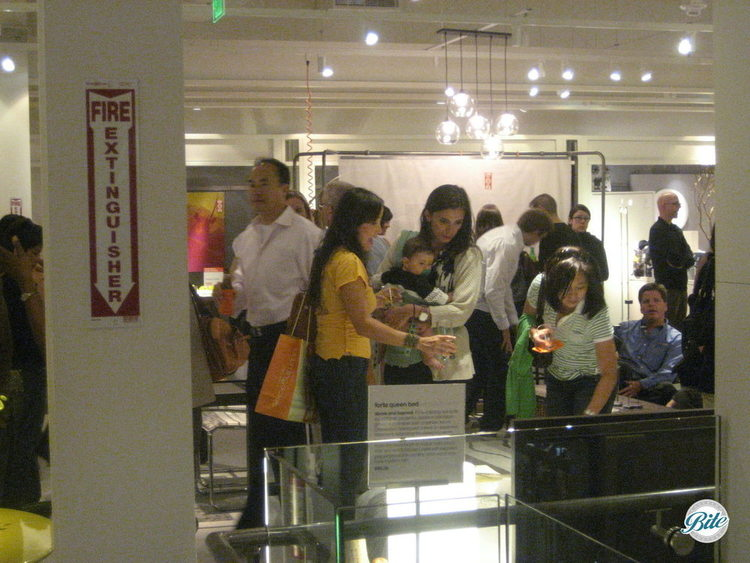Customers check out a display at a store launch event
