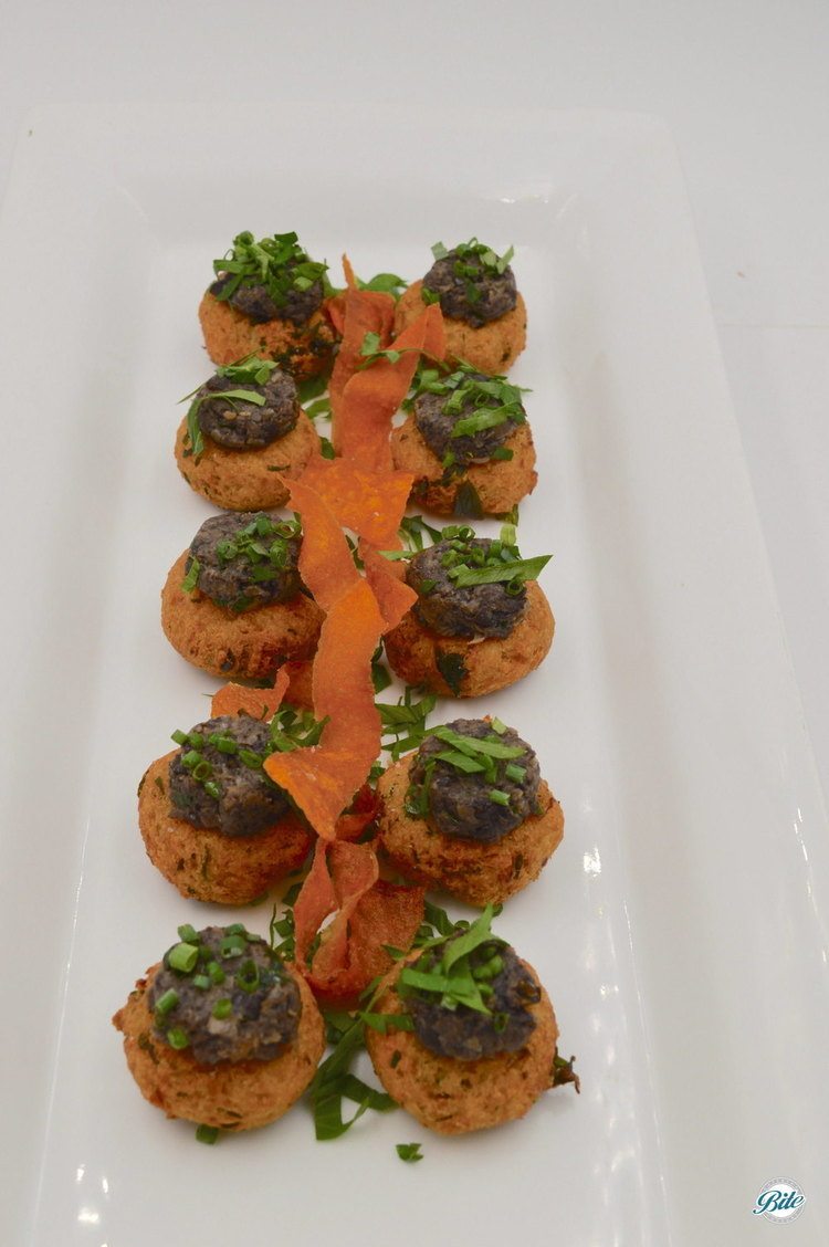 Baked with garbanzo flour, crimini and portabella mushrooms, dressed with a tarragon walnut pesto