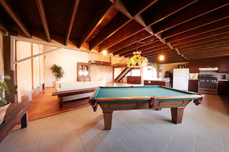 Pool table in the east loft behind the kitchen