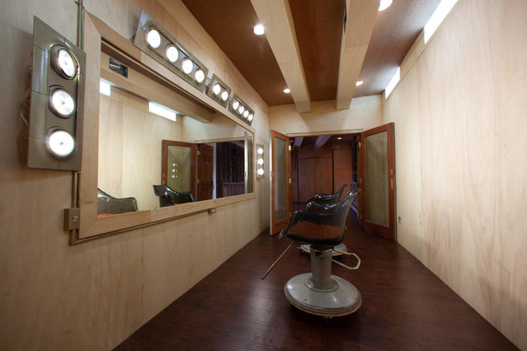 Studio East makeup room includes a very large mirror and lights