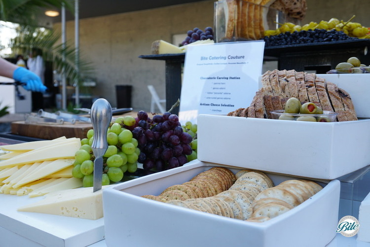 Bread, olives, cheese, grapes, and crackers on charcuterie station