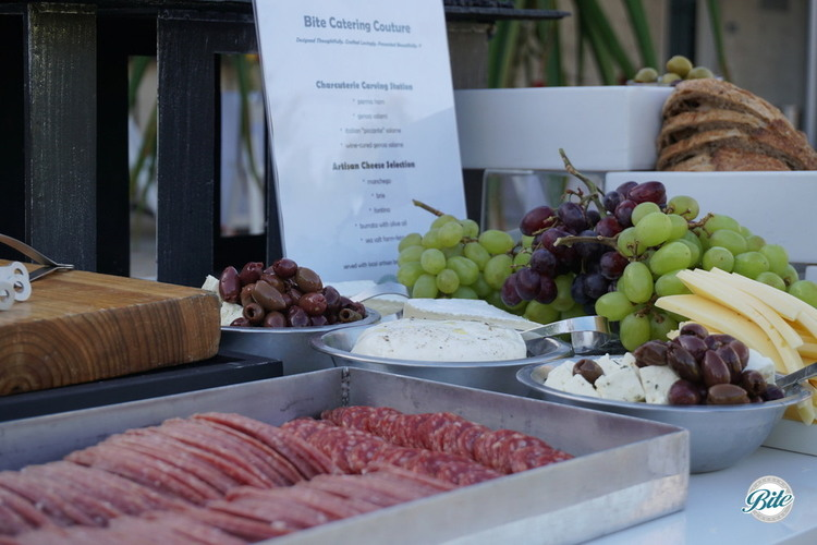 Sliced salami, cheese, olives, stuffed olives, cheese, grapes on charcuterie station