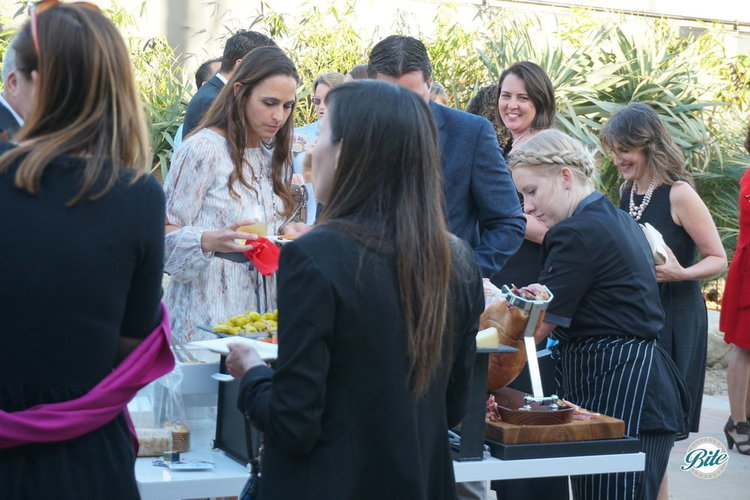 Guests enjoy being served freshly sliced prosciutto by Chef Carrie at the Charcuterie Station