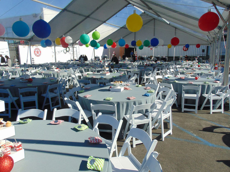 Large outdoor private event area set up with tables and balloons at the Automobile Driving Museum