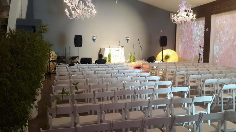 Chairs set up for ceremony in the Casa Bianca space of Unici Casa