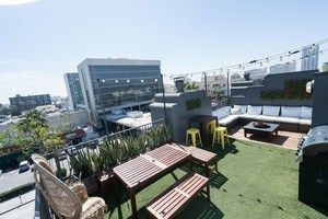 Roof deck overlooking Santa Monica near the beach. Fire pit, lounge seating, and multiple tables make it a flexible and fun space that takes advantage of ocean breezes.