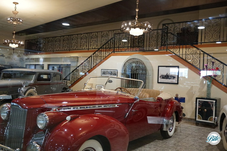 Vintage cars from the 1930's on display with a grand staircase behind (perfect for pictures!)