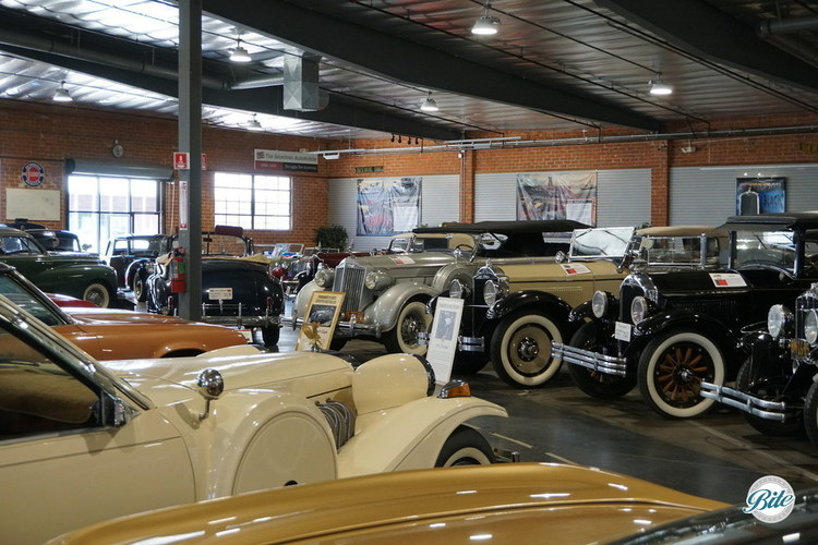 A large exhibit space filled with vintage cars from Model T to modern day!
