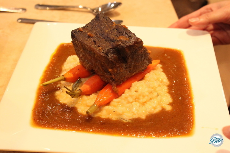 Braised Short Rib with mushroom risotto cake, honey glazed roasted carrots and red wine pan sauce