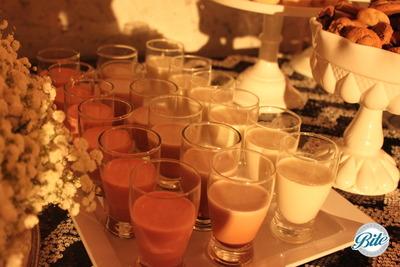 Stawberry, chocolate and regular milk shots with fresh cookies on wedding reception dessert buffet