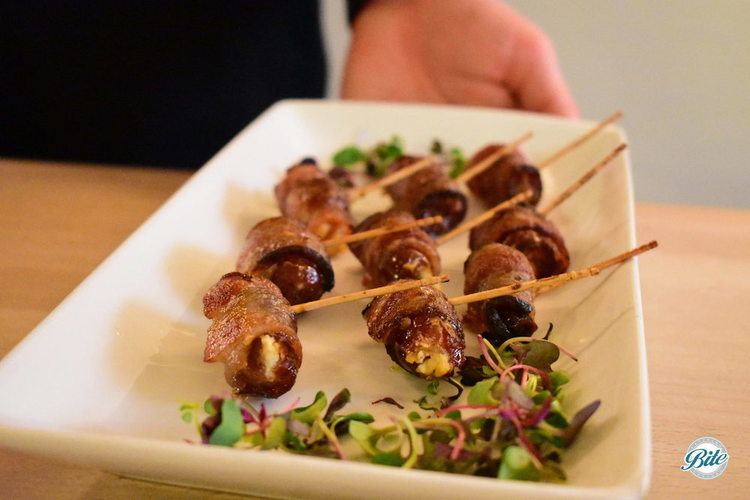 Bacon wrapped dates with goat cheese and marcona almond. Presented passed on toothpicks