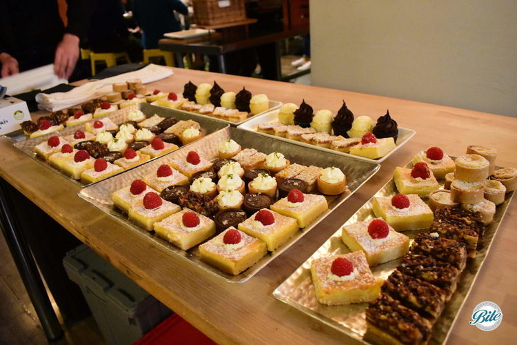 Setting up the dessert assortment. Lemon bars, mini key lime pies, mini cupcakes, and much much more!
