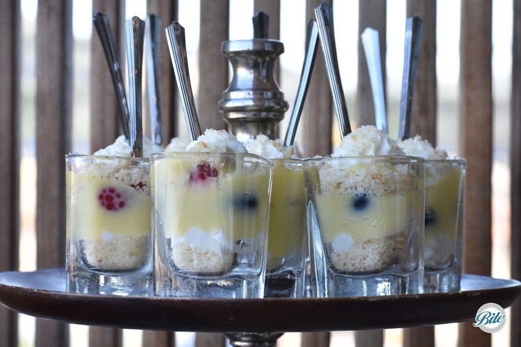 Lemon curd trifle with fresh berries, cake, curd and cream - served in shot glasses with a mini spoon