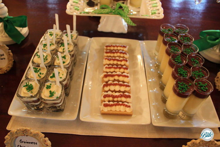 St. Patrick's Day party dessert display with Irish coffee pot de creme, chocolate Guinness cake shot and Irish shortbread