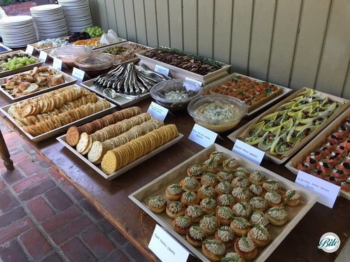 Buffet Table With Appetizers on Wooden Trays