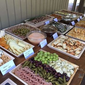 Buffet Table with Highlighted Hearty Platters on Wooden Trays