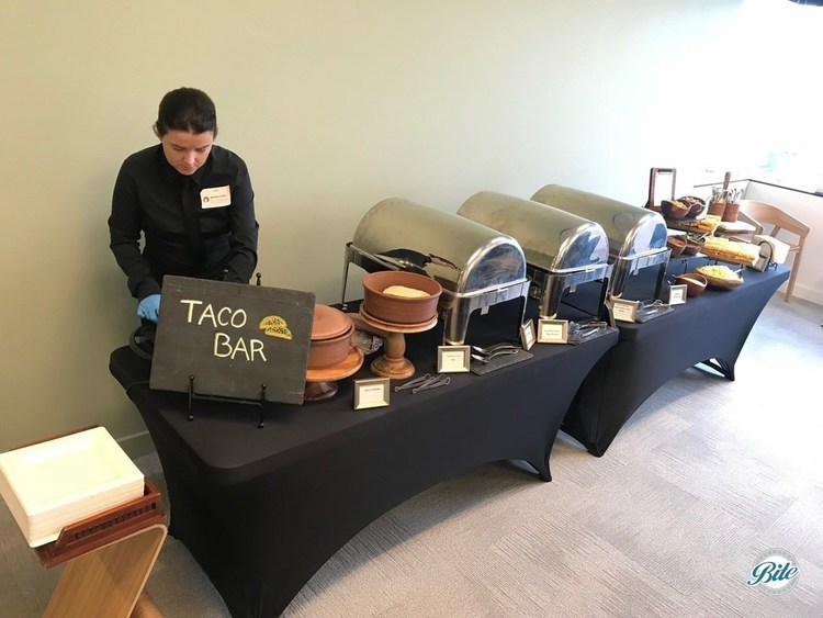 Taco Bar setup with steel chafers, tortillas, and toppings