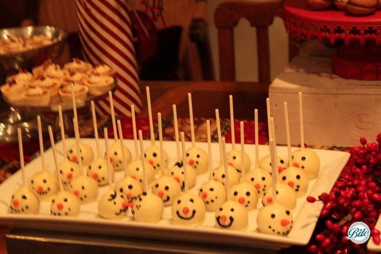 Snowman cake pops on holiday dessert display