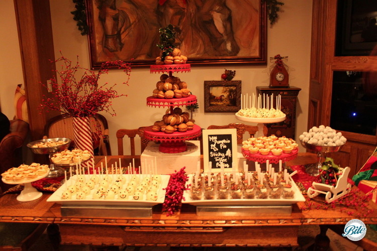 Assorted desserts on holiday dessert display including cake pops, sticky toffee pudding
