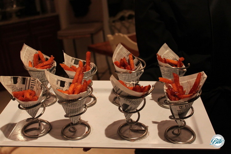 Sweet Potato Fries in metal cones with newspaper decor cone