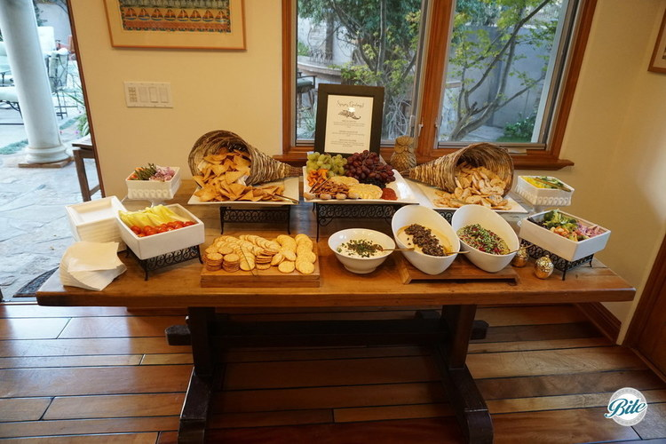 Thanksgiving themed snacks prior to dinner. Brie en croute with grapes and crackers. smoked salmon dip with olive oil crostini and market crudite. Meze duo platter with edmame hummus and classic hummus, served with pita chips and crudite.