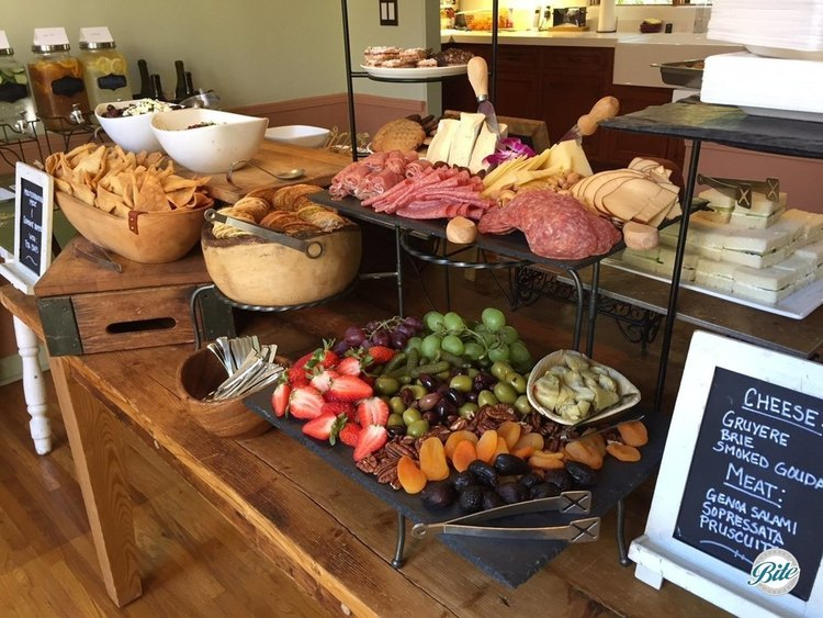 Rustic wooden table covered with appetizer buffet