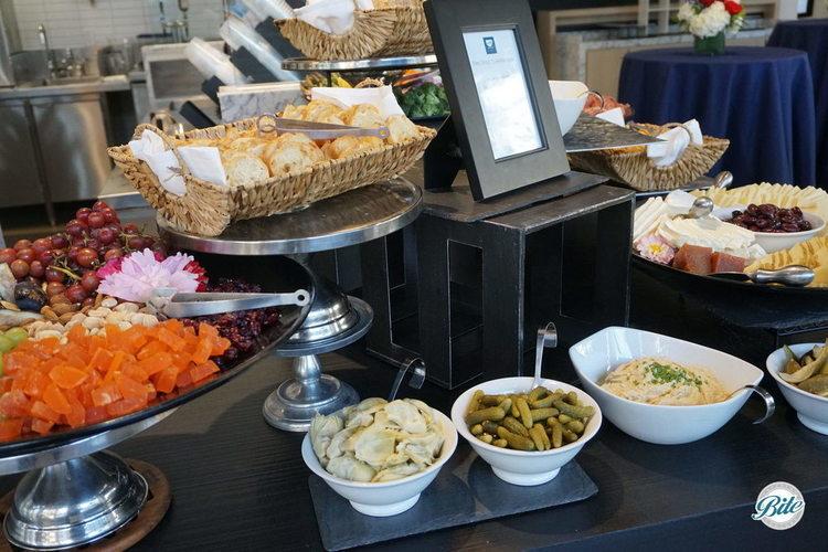 market crudites display served with homemade ranch dip, green goddess dip and hummus selection