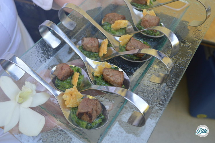 Wagyu Steak with truffle creamed spinach and a parmesan crisp. Served on spoons and tray passed