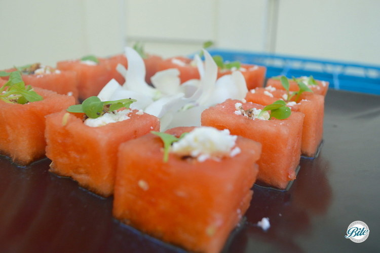 Refreshing watermelon salad cube with French feta, micro arugula and balsamic reduction. Tray passed.
