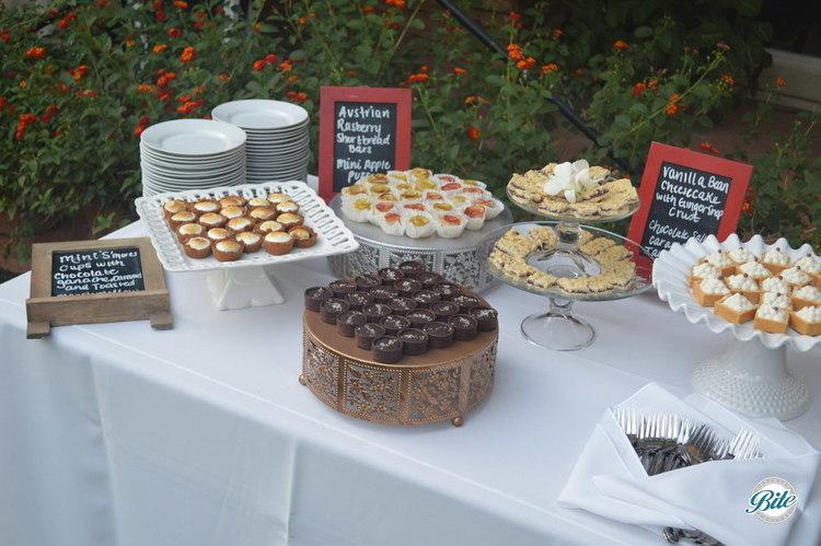 Mini s'mores cups, Austrian raspberry shortbread bars, mini apple puffs, vanilla bean cheesecake, chocolate salted caramel tartlets