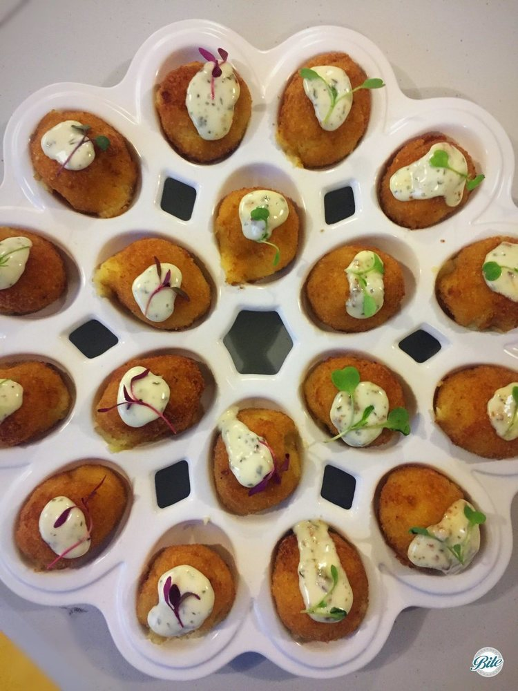 Mac'n Cheese Croquettes finished with truffle aioli and micro garnis. Tray passed in oval tray