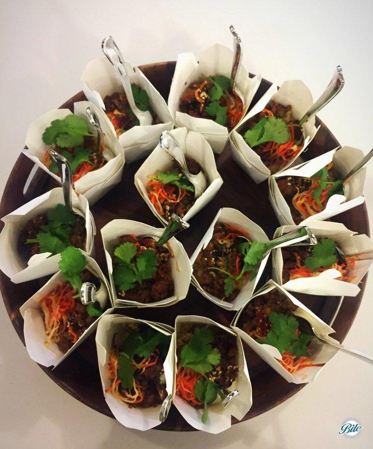 Mini Banh Mi Rice Takeout Boxes with brown rice, pork, sriracha, banh mi veggie, cilantro. Tray passed.