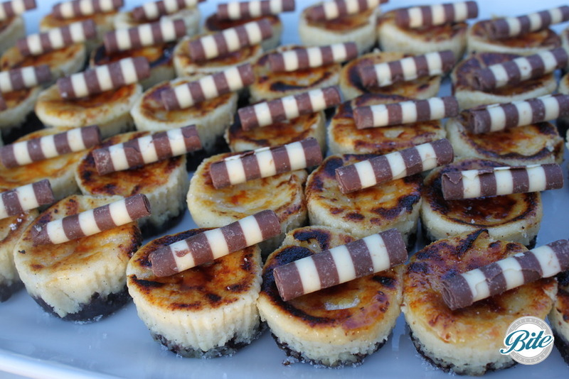 Creme brulee bites with chocolate straw and chocolate crust