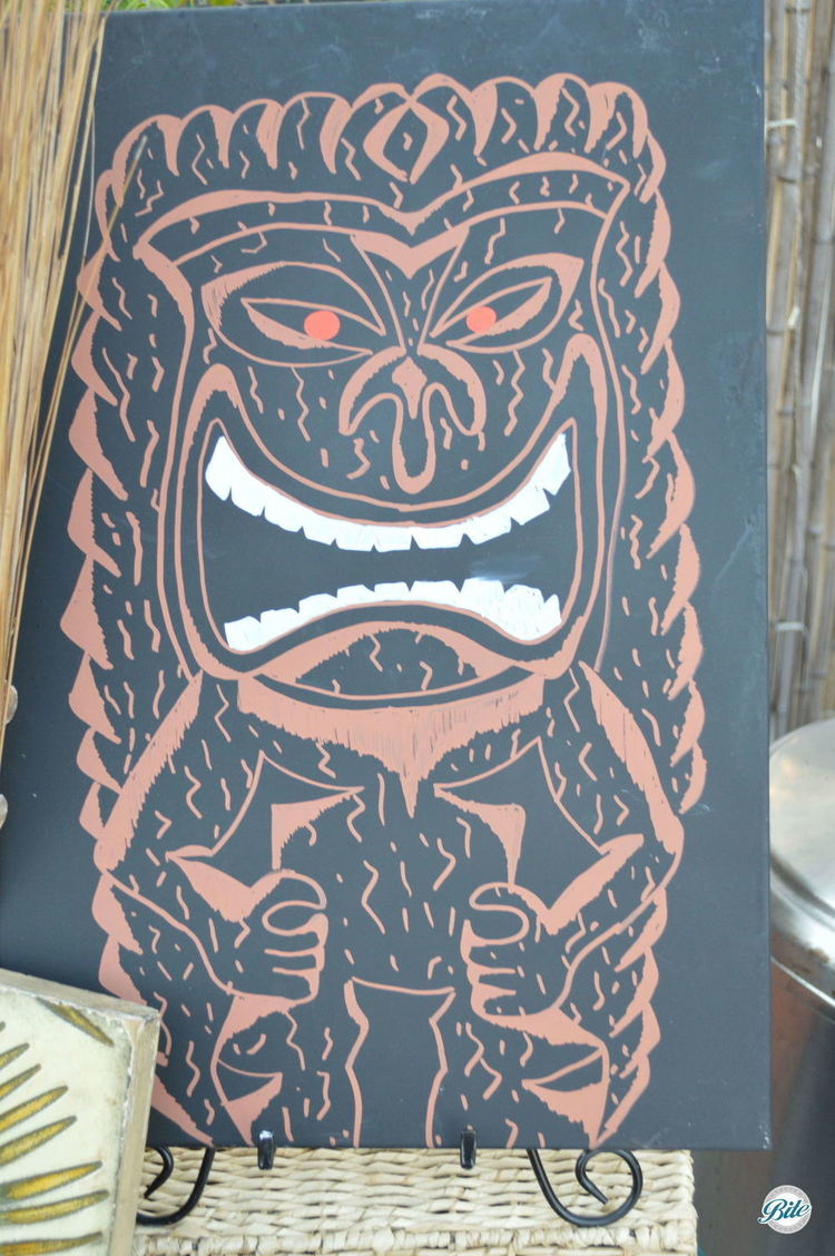 Laughing Tiki Man sign on display