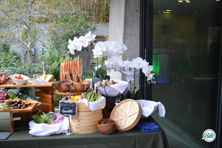 Cheese selection served with fresh fruit, dried fruit and assorted crackers, artisan bread, nuts and cheese preserves. Market display of crudités, fresh fruits and dipping sauces .  Outdoors just outside in the JACCC garden.