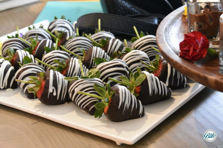 Long stemmed chocolate covered strawberries. Hand dipped In dark European Chocolate and drizzled with white chocolate. Yum!