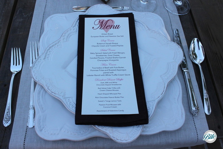 A Valentine's Day menu with courses for soup, salad, main, and dessert.