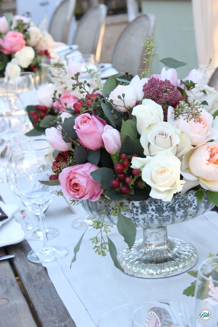 Beautiful roses in a crystal vase on a wooden table