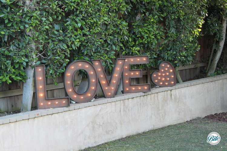 Love in lighted letters. In the garden.