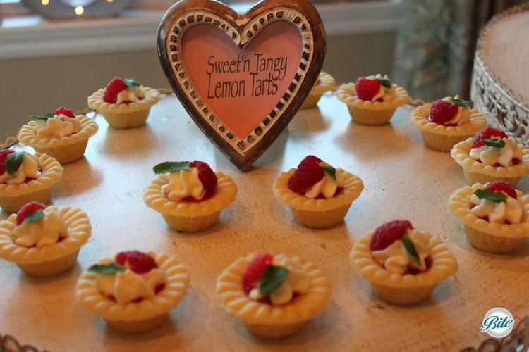 Sweet and tangy mini lemon tarts with fresh berries.