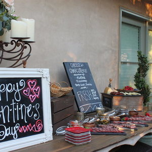 Cheese and Charcuterie Table Decorated with Chalkboard Signage