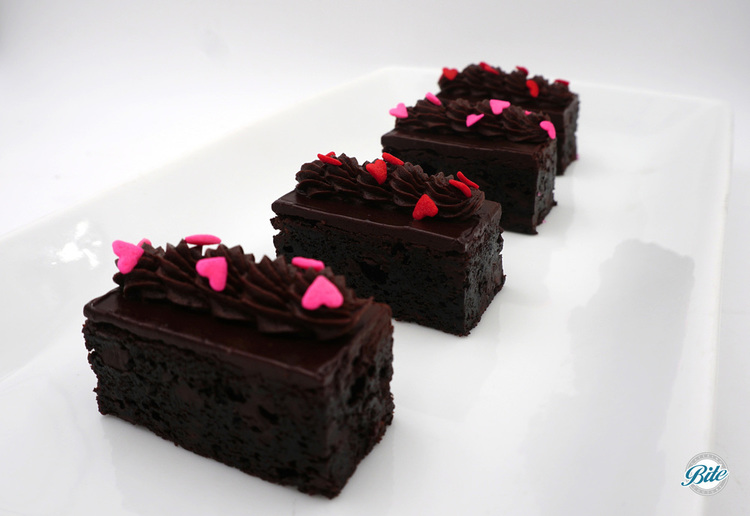 Chocolate truffle brownies with rich dark chocolate frosting and sugar hearts