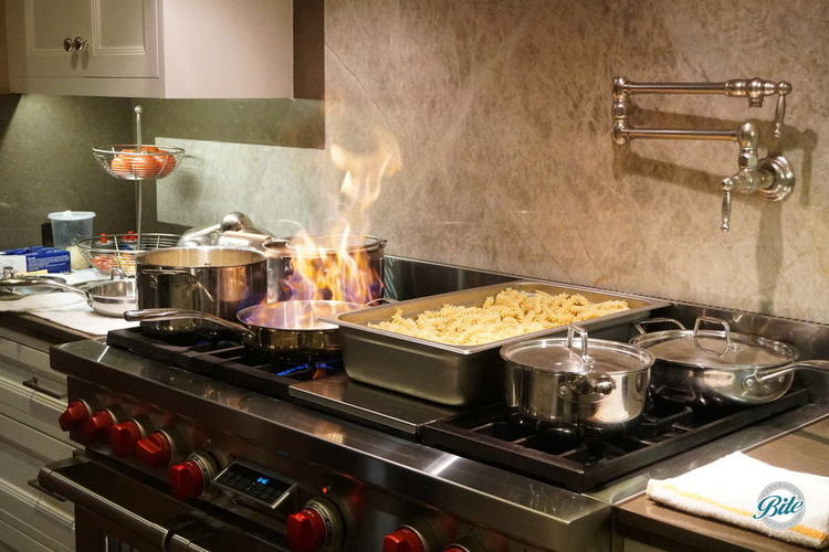 Pasta station with cognac flambe into a parmesan wheel