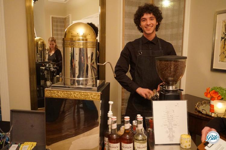 Barista mans a fresh coffee station