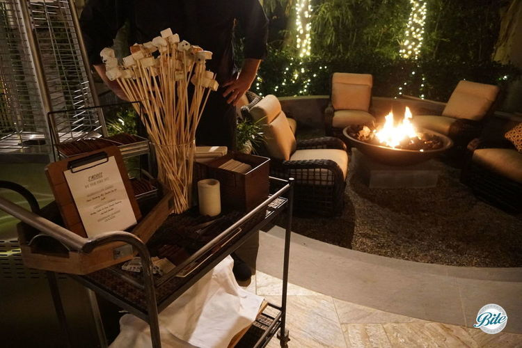 S'mores station with marshmallow sticks, homemade graham crackers, and chocolate