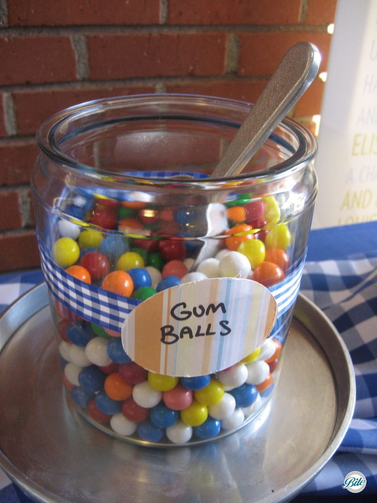 Gumballs in a jar on the candy display