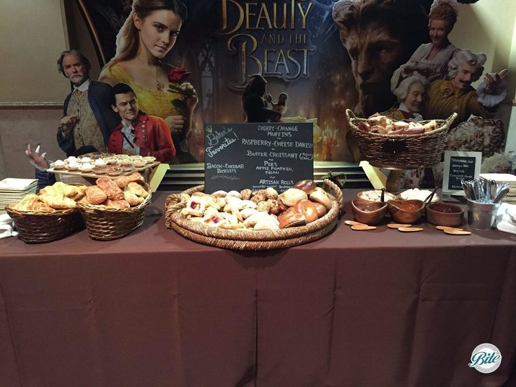 Assorted breakfast pastries in front of movie poster in theater.