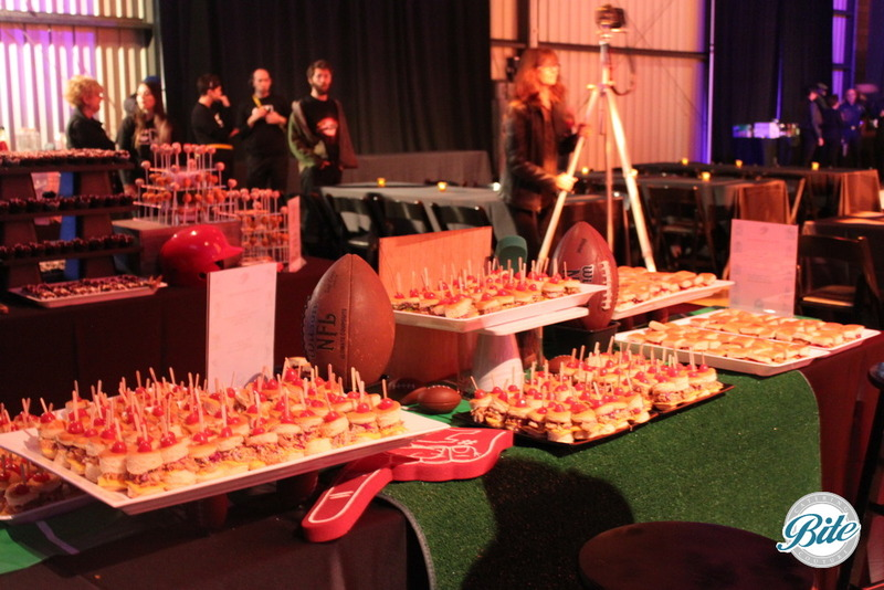 Slider station with game day with themed display of footballs, astro turf and more