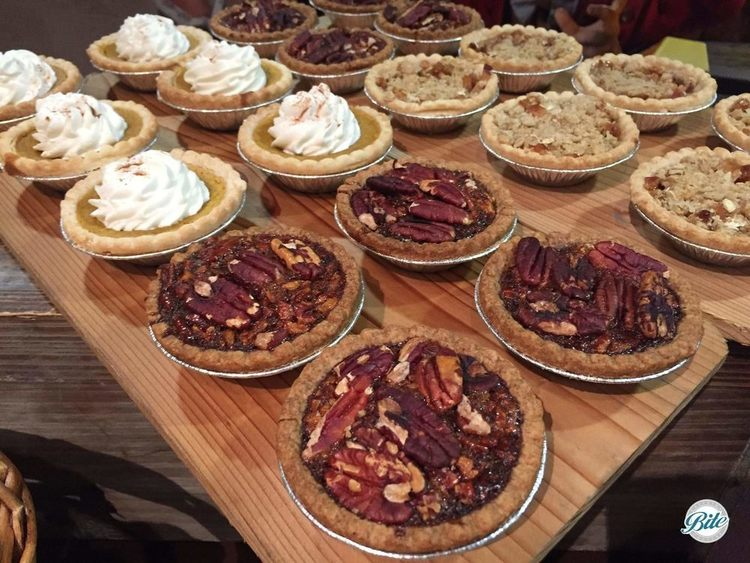 Assorted individual pies including apple, pumpkin, and pecan
