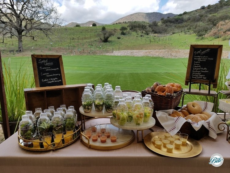 Shaker Salad station and bagels on the buffet overlooking a vineyard